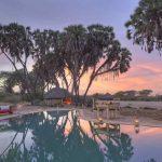 Zonsondergang zwembad - Saruni Rhino